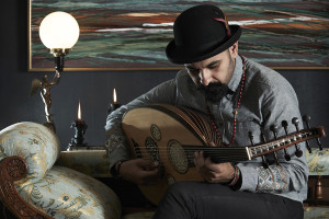 Tawadros plays oud on couch